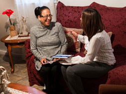 Two women talk in living room about a path to better health